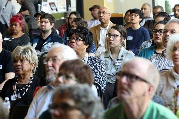 Multi-generational crowd views 'The Wake of Vanport' at the April 2016 screening
