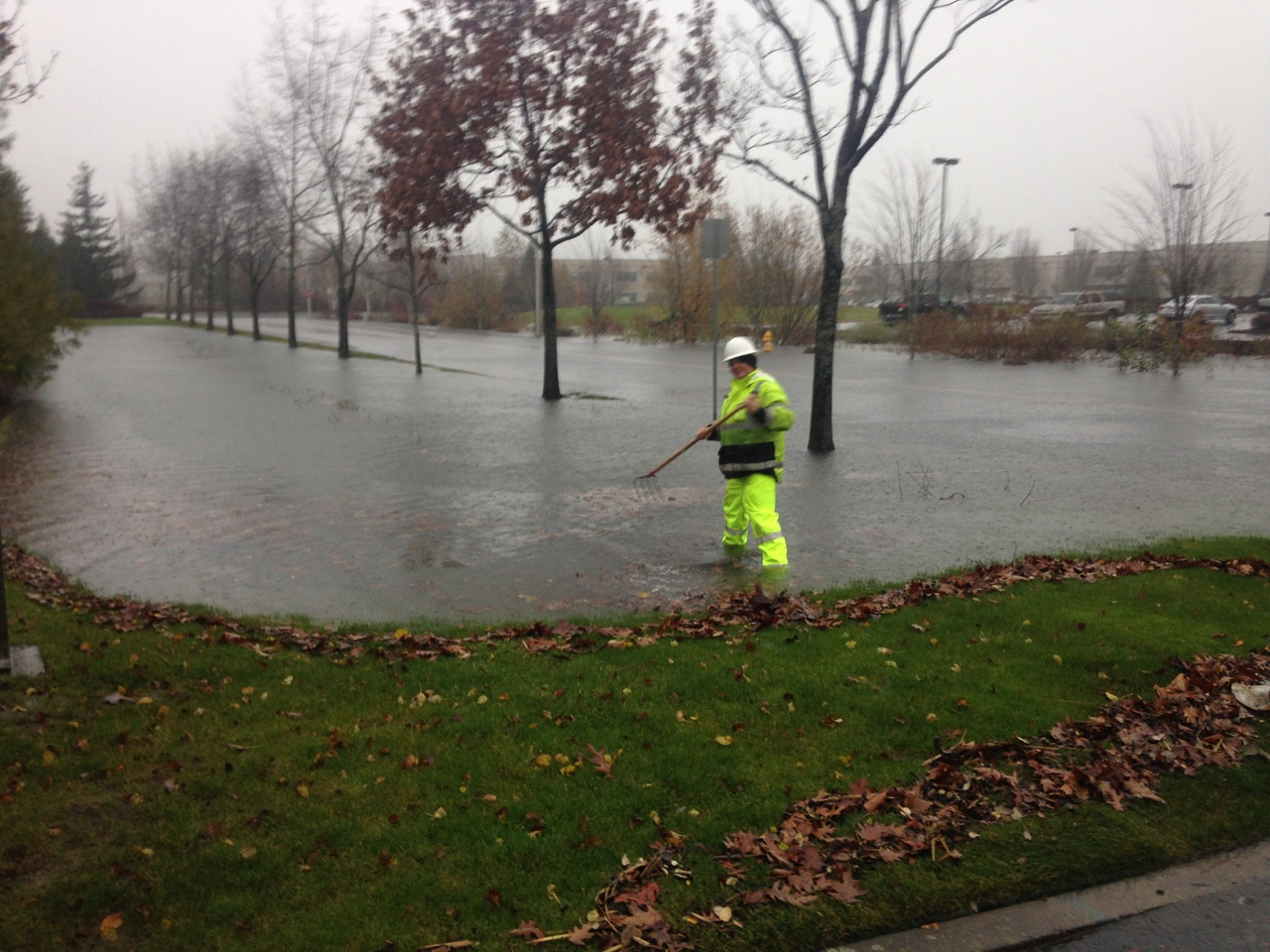 Photo of drainage district staff cleaning up debris during 2015 high water event