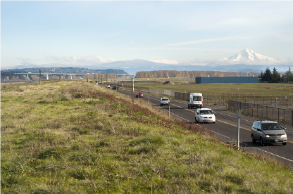 Photo of cars driving along Marine Drive, which is on top of the primary columbia river levee