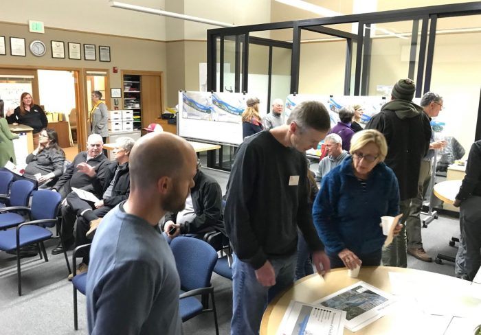 Photo of people discussing the USACE feasibility study during December 2018 open house
