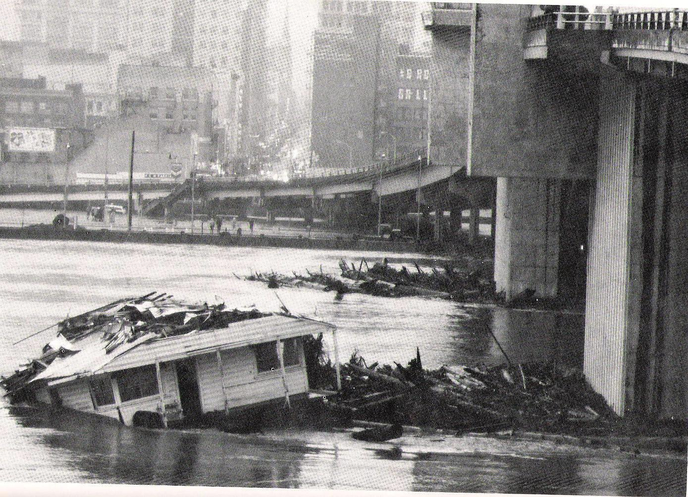 Floating home damaged during Christmas Flood of 1964
