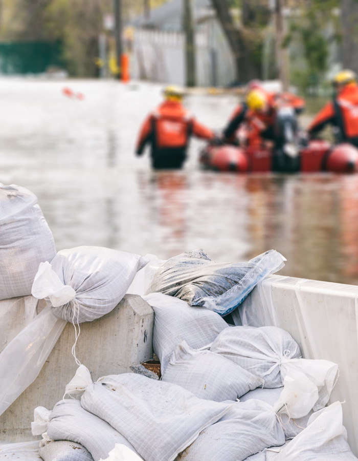 Photo of flood emergency responders and sand bags