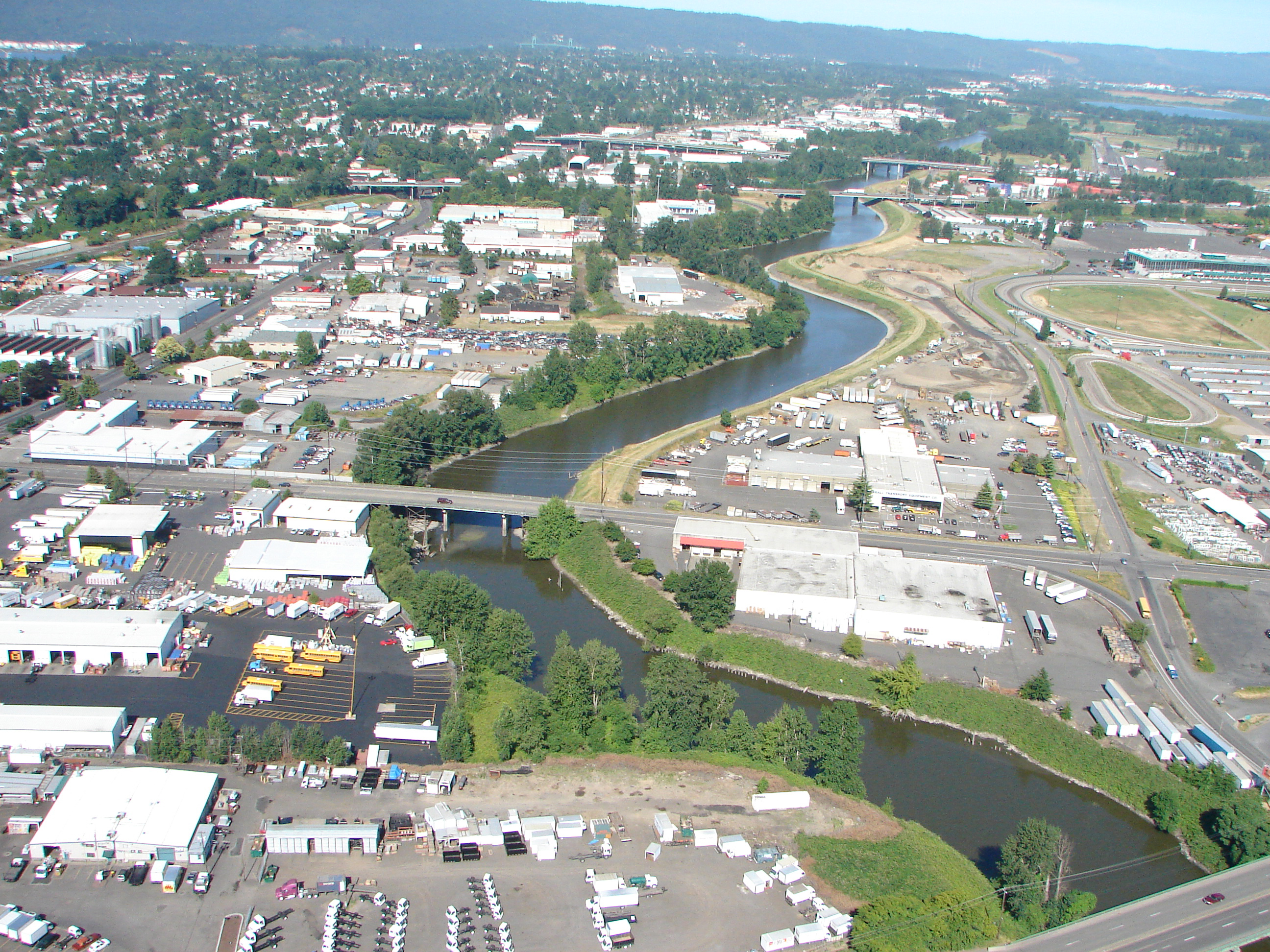 Photo of the Columbia Corridor industrial buildings and the Columbia Slough